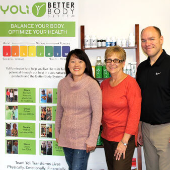 The staff of Montgomery Family Chiropractic standing in front of the nutritional supplement display inside their office