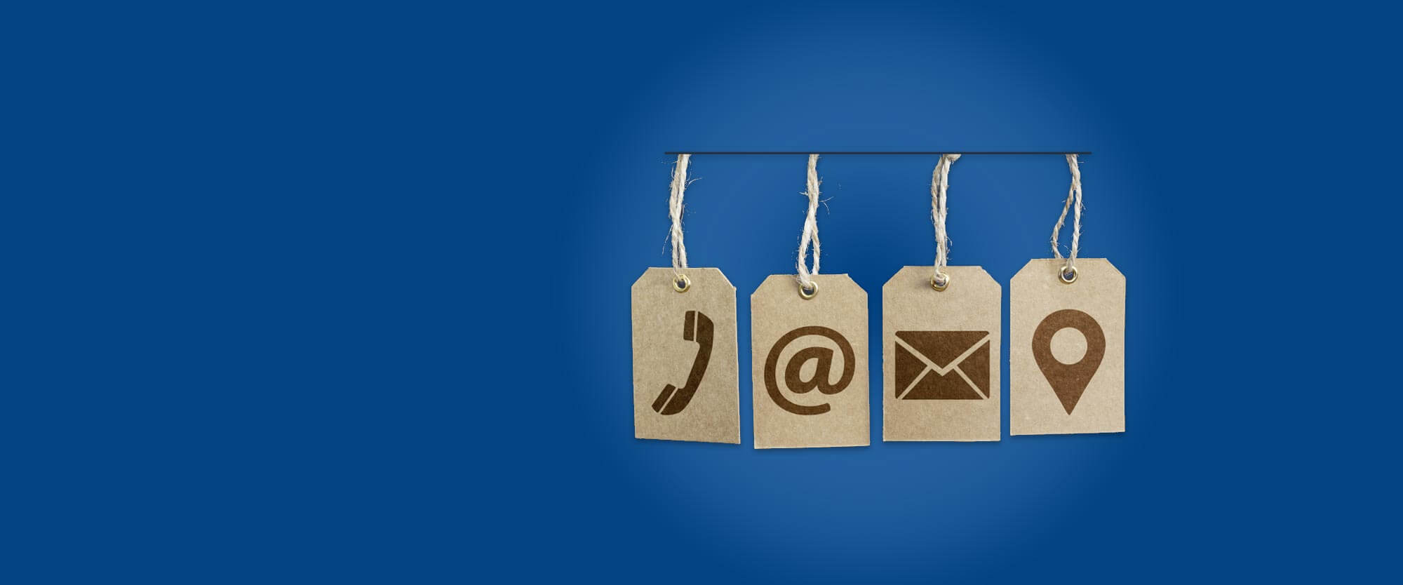 Hanging cardboard tags depicting a phone, email sign, envelope, and map marker pin